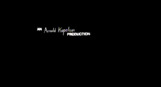 00:06 - 'An Arnold Kopelson Production'