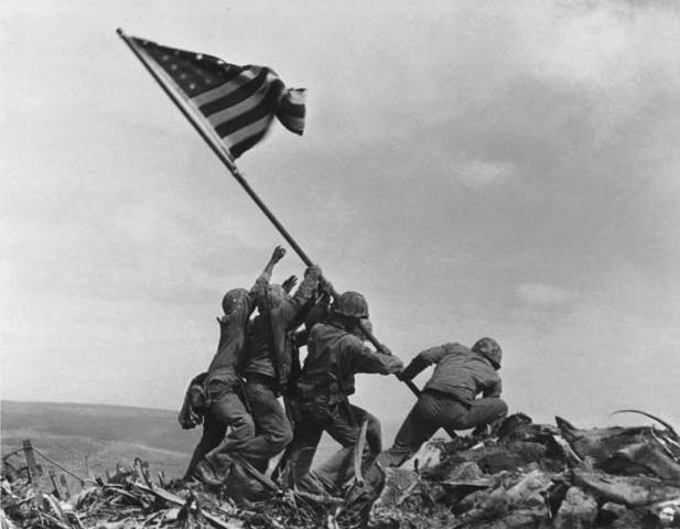 Thirty thousand United States Marines land on Iwo Jima