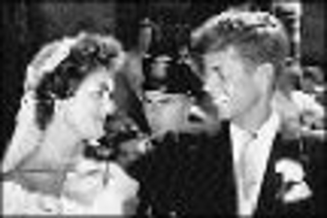 Marries Jacqueline Lee Bouvier in Newport, R.I.