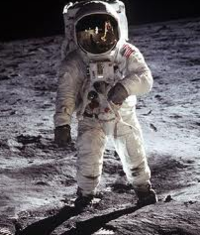 """He delivers a speech saying the US will put a man on the moon """"before the end of this decade."""""""