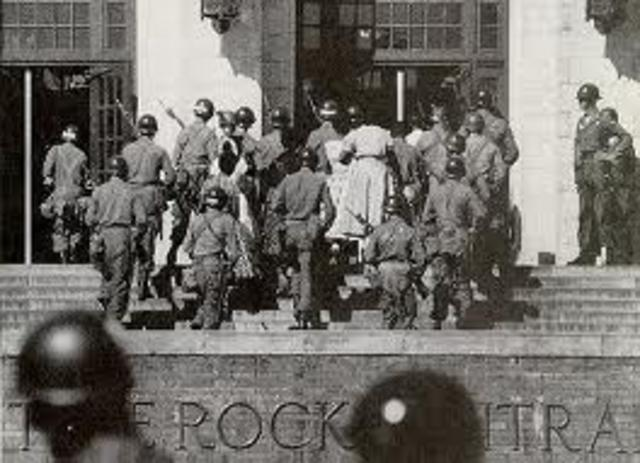 Little Rock 9 entered Central HS escorted by a federal troop.