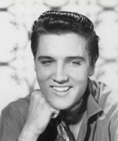 Elvis Presley signs to RCA records beginnign his pop career