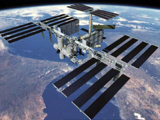 NASA and Boeing officials sign a $5.63 billion contract to design and develop the International Space Station