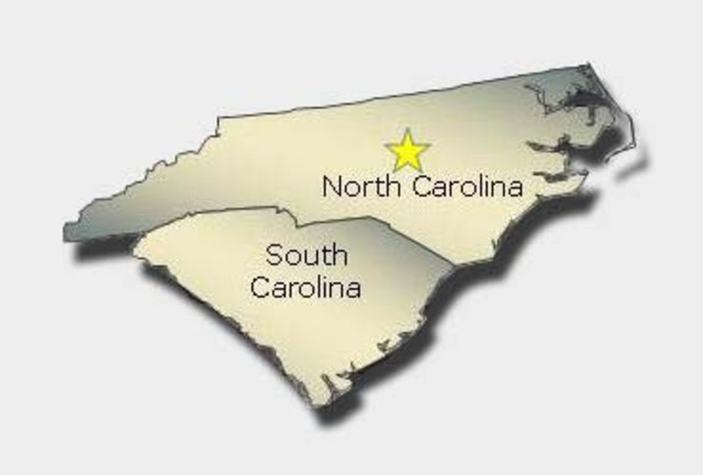 Carolinas were split into the North and South .