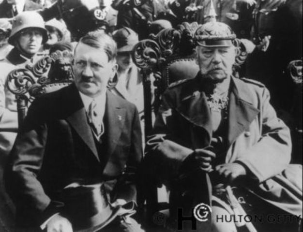 Adolf Hitler becomes head of state and head of government in Germany.
