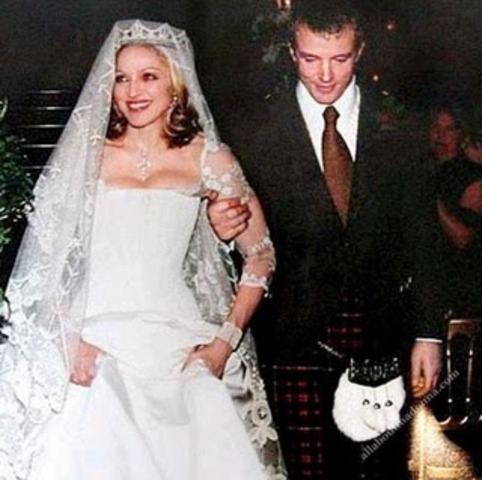 Marries Ritchie at Skibo Castle in Scotland.