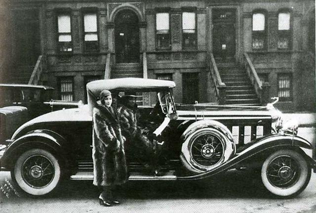 Couple Wearing Raccoon Coats with Cadillac