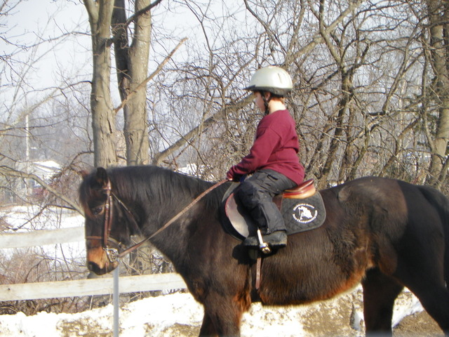 Riding on a pretty horse.