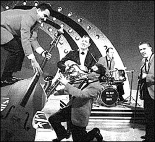 Bill Haley and the Comets  launched a hit called Rock Around the Clock