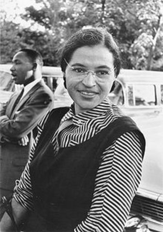 Rosa Parks arrested for refusing to give up her seat on a public bus.