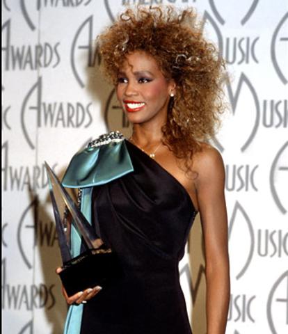Whitney Houston hits #1
