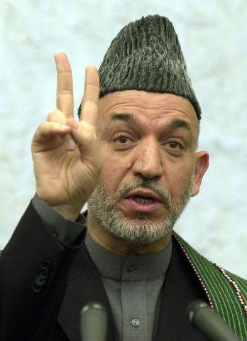 Karzai becomes president