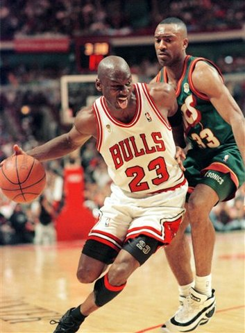 Michael Jordan and the bulls win their fourth championships against Seattle Supersonics. He was MVP of the game.