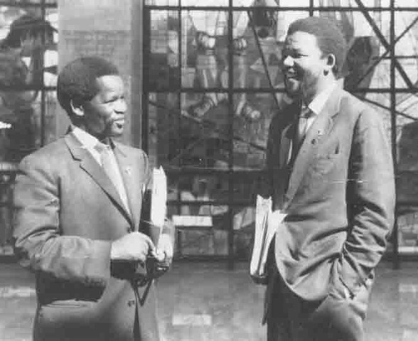Mandela opens South Africa's first black law firm with Oliver Tambo.