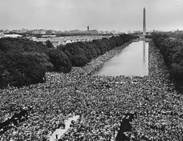 Civil rights rally held by 200,000 blacks and whites in Washington, D.C.