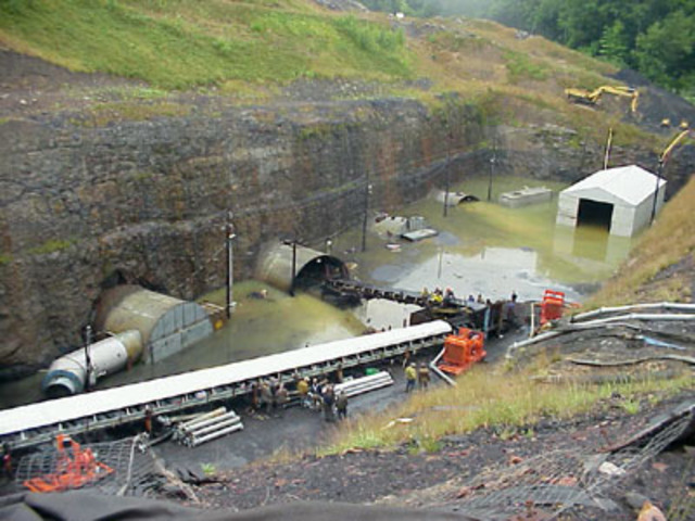 Nine coal miners trapped in the flooded Quecreek Mine in Somerset County, Pennsylvania, are rescued after 77 hours underground.