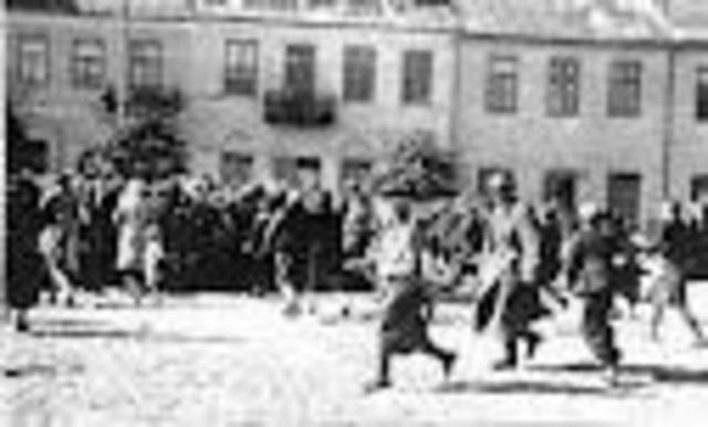 Jews forced to run to get to wagons with 40 pound packs on their backs