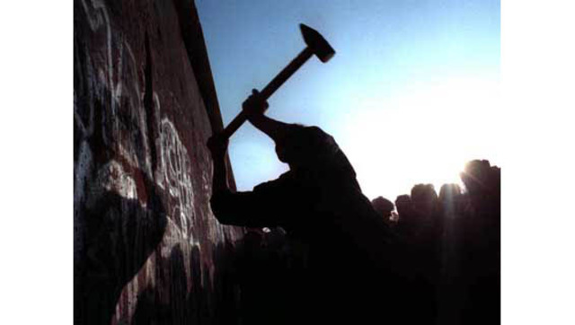 Berlin Wall Comes Tumbling Down