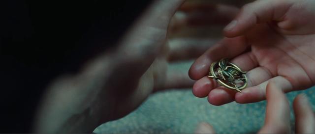 Prim Gives Katniss The Mockingjay-ac7724