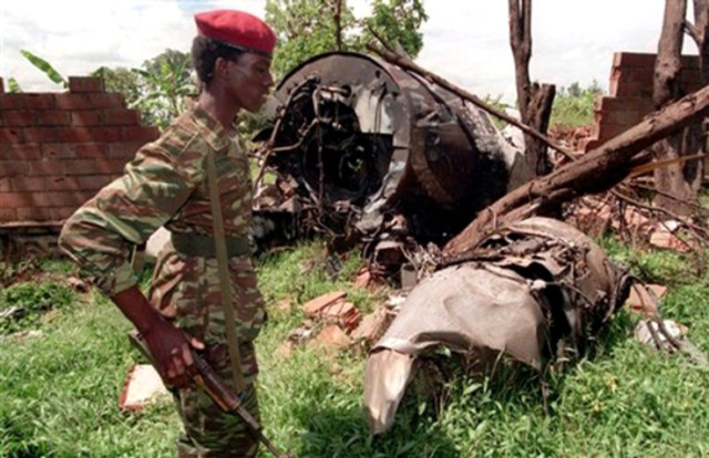 Rwandan President Juvénal Habyarimana is killed when his plane is shot out of the sky.