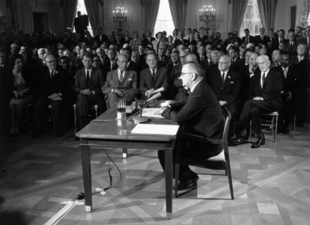 President Signs Civil Rights Act