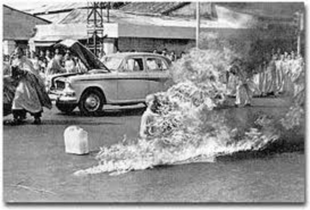 Flames erupt around a Buddhist monk as he set himself on fire to protest government religious policies