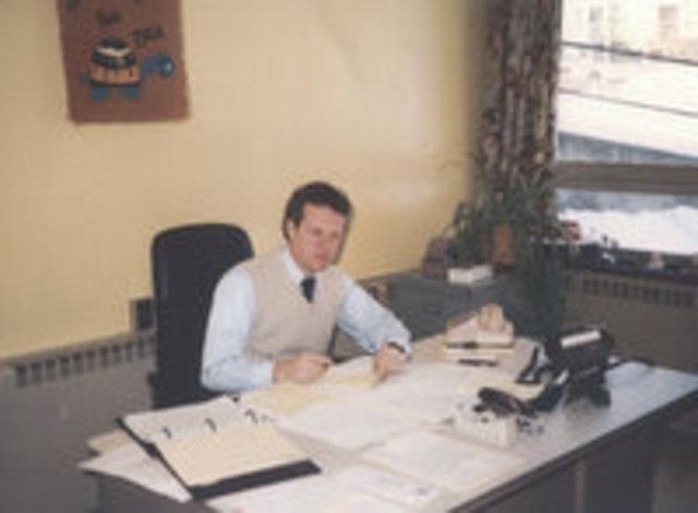 John P. Cook, New Principal