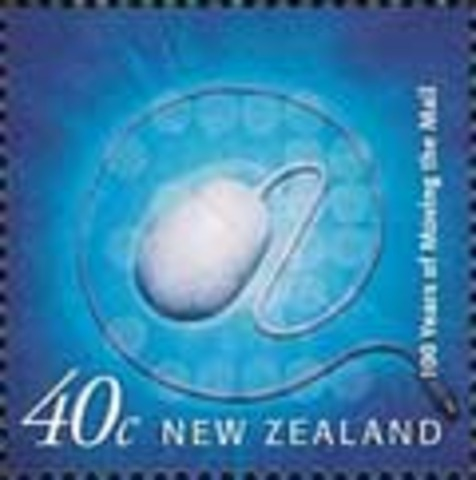New Zealand issues a 40-cent postage stamp depicting a personal computer mouse, part of a series for the 100th anniversary of penny universal postage.