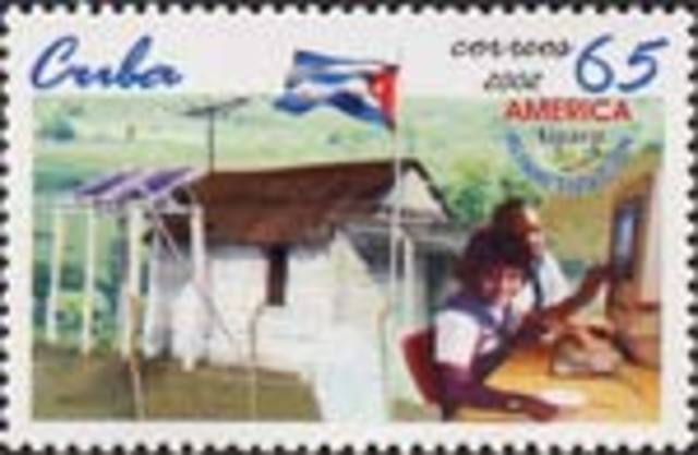 Cuba issues a 65 centavos postage stamp depicting children using a personal computer