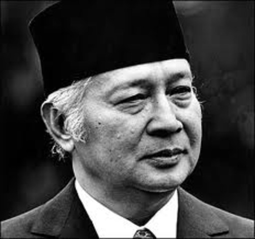 Sukarno hands over emergency powers to General Suharto, who becomes president