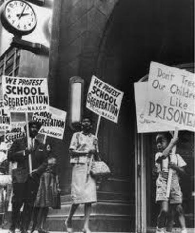 World Events: Segregation Ruled Illegal in U.S.