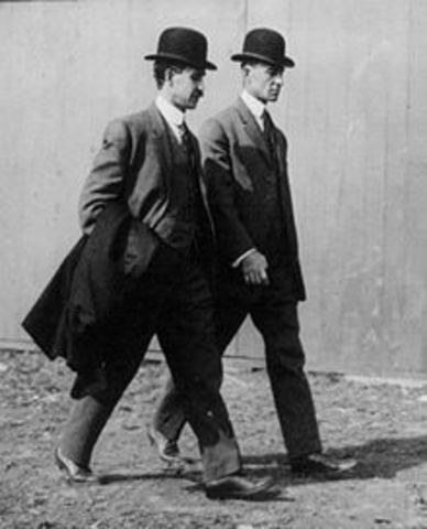 Wright brothers take first flight