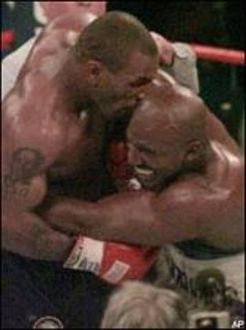 Sports and Music:Mike Tyson bites Holyfield