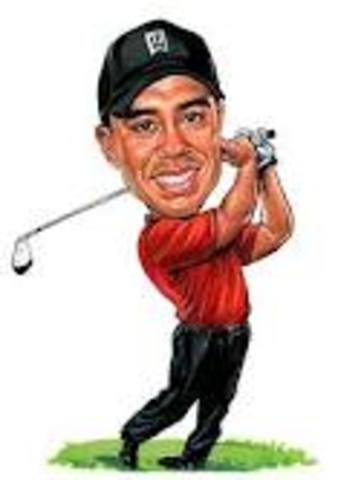 Sports and Music: Tiger Woods wins his first Masters Golf Championship