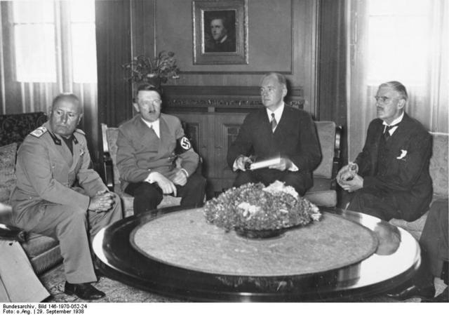 British Prime Minister Chamberlain appeases Hitler at Munich Conference