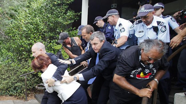 3.Ms Gillard was escort through mobs of angary protesters