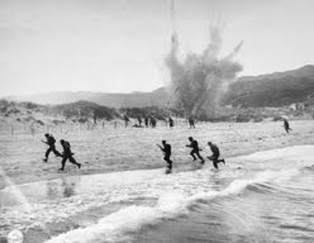 """British and U.S. troops successfully land on the Normandy beaches of France, opening a """"Second Front"""" against the Germans. This day is known as D-Day"""