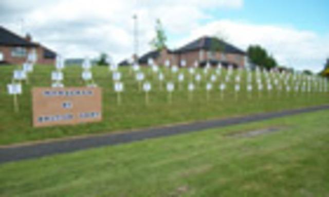 a Roman Catholic doorman at a Belfast night club and nephew of Gerry Adams, is killed.