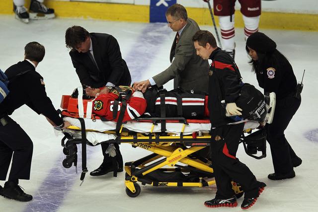 Hossa suffers possible concussion