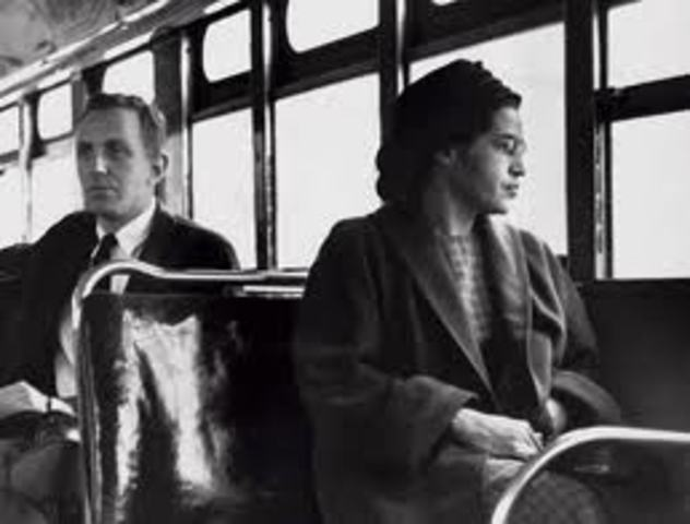 Rosa Parks refuses to get off bus