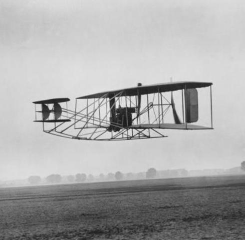 Wright Brothers fly first powered airplane