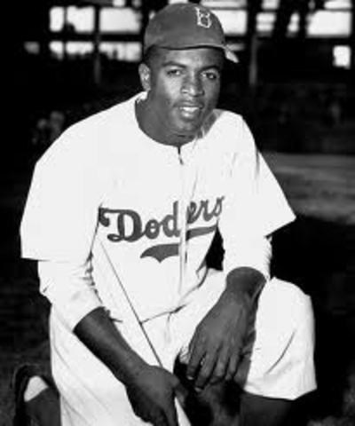 Jackie Robinson breaks baseball's color barriers