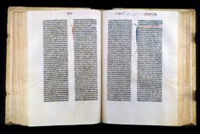 Gutenberg prints the Bible