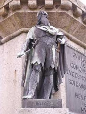 Le chef viking Rollon obtient des terres des Francs de fonde la Normandie en France.