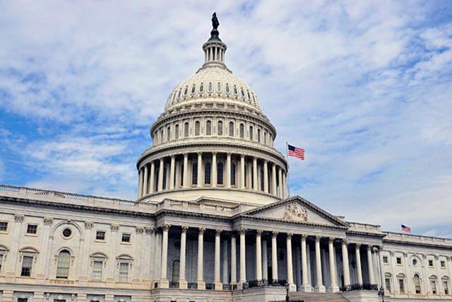 U.S. Senators leave the house
