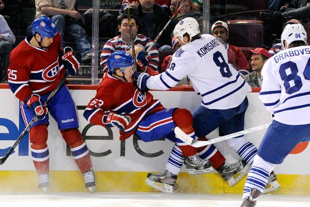Leafs spend big to sign Mike Komisarek