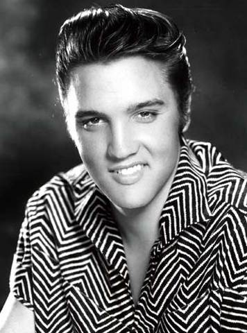 Elvis records his first song