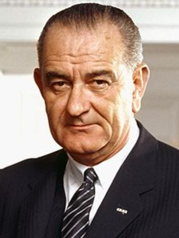 Lyndon B. Johnson signs the Civil Rights Act in 1964.