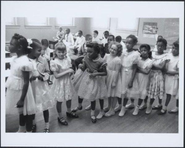 Supreme Court orders schools desegregated in Brown v. Board of Education