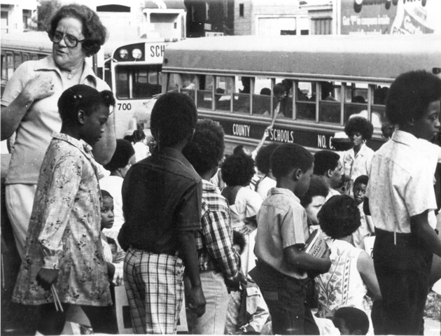 Aiding desegregation through busses